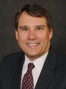 James P. Devine